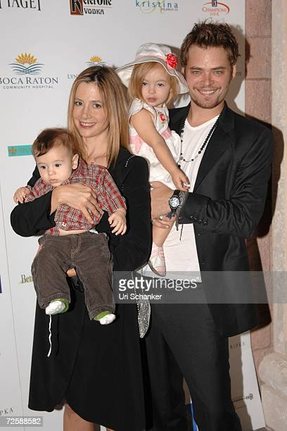 Mira Sorvino and Christopher Backus pose with their daughter Mattea Angel and son Johnny at the unveiling of Paul Sorvino's sculpture at the Boca...