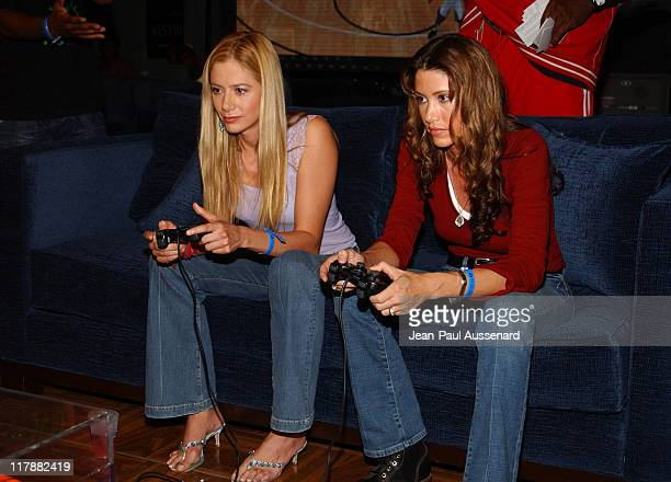 Mira Sorvino and Shannon Elizabeth during PlayStation 2 and Mark Wahlberg Host Celebrity Gaming Tournament for Charity Inside at Club Ivar in...