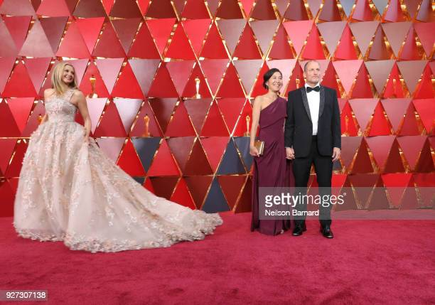 Mira Sorvino Laura Louie and Woody Harrelson attend the 90th Annual Academy Awards at Hollywood Highland Center on March 4 2018 in Hollywood...