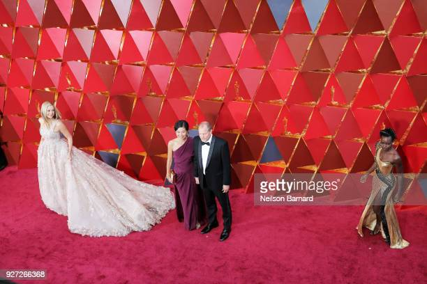 Mira Sorvino Laura Louie Woody Harrelson and Lupita Nyong'o attends the 90th Annual Academy Awards at Hollywood Highland Center on March 4 2018 in...