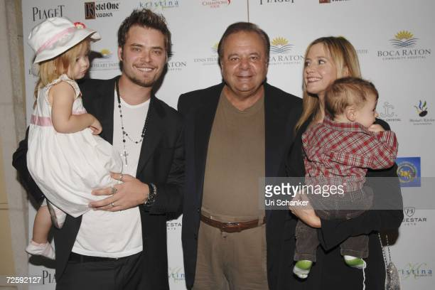 Mira Sorvinos' husband Christopher Backus holds daughter Mattea Angel while standing next to Paul Sorviono Mira Sorvino and son Johnny at the...