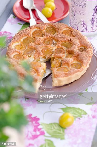 Mirabelle tart on laid table