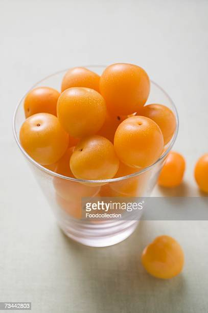 Mirabelles in and beside a glass