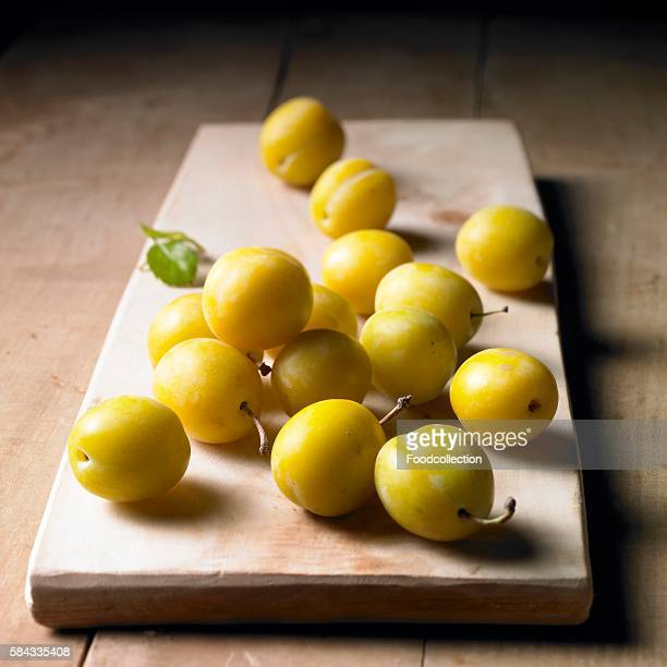 Mirabelles on a wooden board