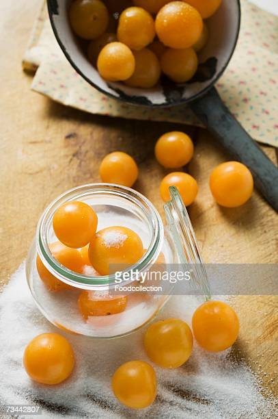 Mirabelles with sugar and preserving jar