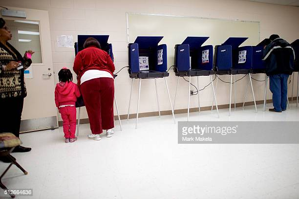 Miracle Leverett joins her grandmother Carolyn Leverett to vote at the Polo Park polling precinct for the South Carolina Democratic Presidential...
