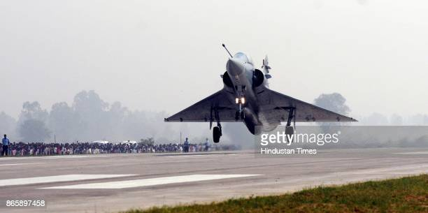 Mirage 2000 makes touchdown on the LucknowAgra Expressway near Bangarmau in Unnao district on October 24 2017 around 65 km from Lucknow India As many...