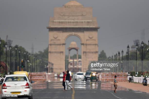 Mirage appears on Rajpath against the backdrop of India Gate as mercury touched 44 degree celsius, on May 29, 2019 in New Delhi, India.
