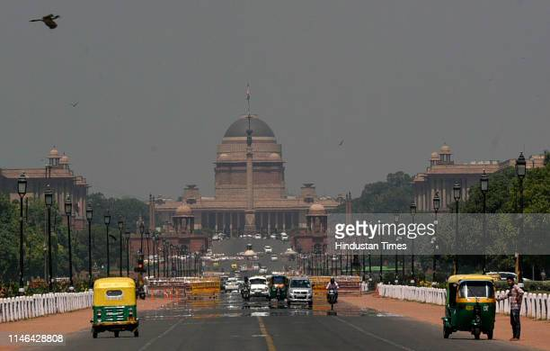 Mirage appears on Rajpath against the backdrop of Rashtrapati Bhawan as the mercury soars, on May 27, 2019 in New Delhi, India.