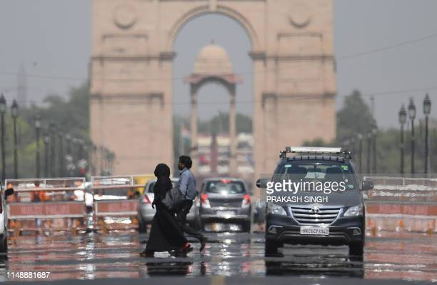 Mirage shimmers over Rajpath leading to India Gate as temparatures rise in New Delhi on June 10, 2019.