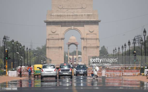 A mirage shimmers over Rajpath leading to India Gate as temparatures rise in New Delhi on June 10 2019