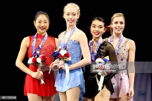 Mirai Nagasu Bradie Tennell Karen Chen and Ashley Wagner pose on the medals podium after the Championship Ladies during the 2018 Prudential US Figure...