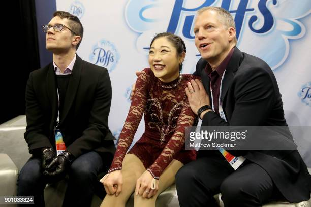 Mirai Nagasu celebrates in the kiss and cry with coaches Drew Meekins and Tom Zakrajsek after skating in the Ladies Short Program during the 2018...