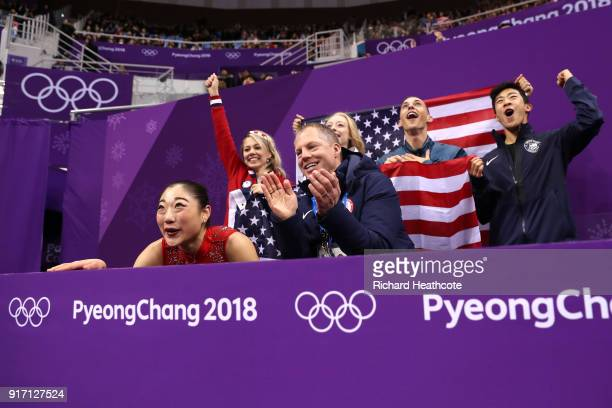 Mirai Nagasu of the United States and teammates Alexa Scimeca Knierim Bradie Tennell Adam Rippon and Nathan Chen and coach Tom Zakrajsek of the...