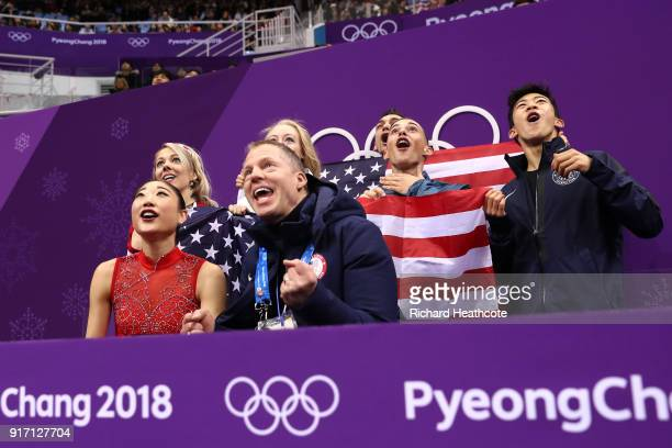 Mirai Nagasu of the United States and teammates Alexa Scimeca Knierim Bradie Tennell Adam Rippon Nathan Chen and coach Tom Zakrajsek of the United...