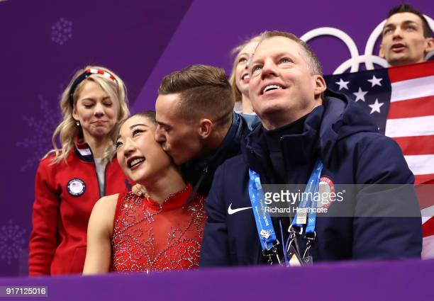 Mirai Nagasu of the United States is kissed on the cheek by teammate Adam Rippon of the United States after her routine in the Figure Skating Team...