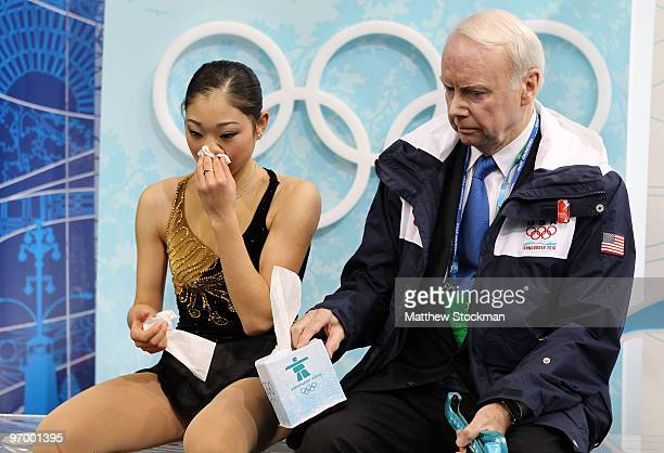 Mirai Nagasu of the United States wipes blood from her nose in the kiss and cry area in the Ladies Short Program Figure Skating on day 12 of the 2010...