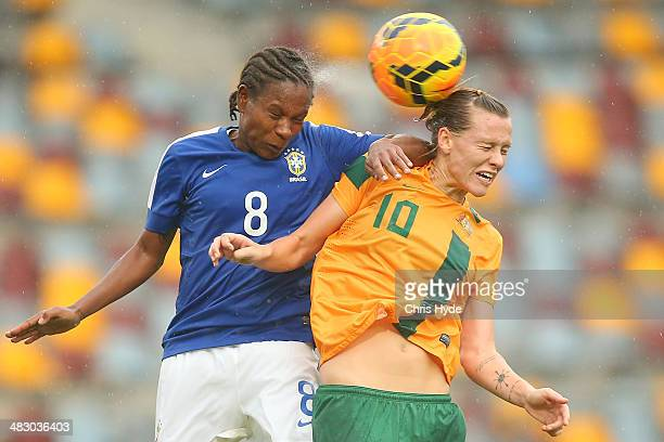 Miraildes Mota of Brazil and Emily VanEgmond of Australia compete for the ball during the Women's International Friendly match between the Australian...