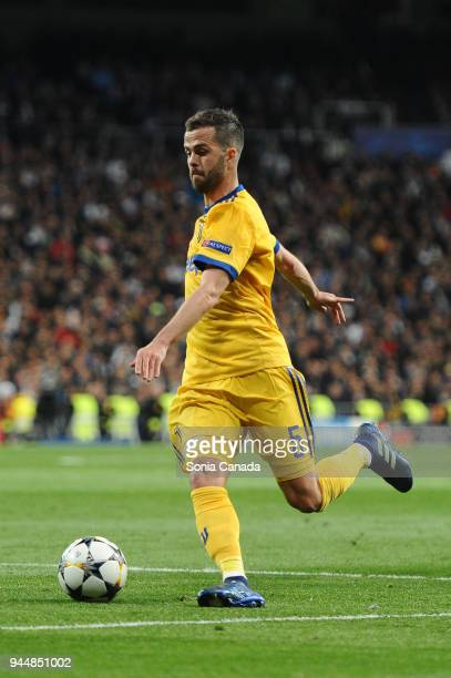 Miralem Pjanic #5 of Juventus during the UEFA Champions League Quarter Final Leg Two between Club Real Madrid and Juventus at Santiago Bernabeu on...