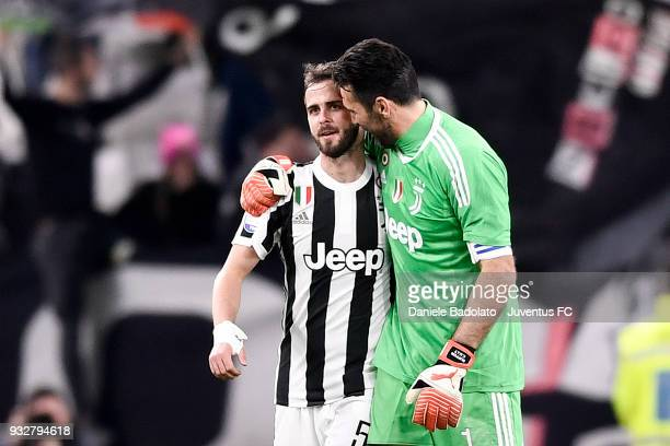 Miralem Pjanic and Gianluigi Buffon of Juventus during the serie A match between Juventus and Atalanta BC on March 14 2018 in Turin Italy
