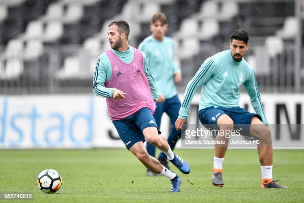 Miralem Pjanic and Sami Khedira during the Juventus training session at Juventus Center Vinovo on May 2 2018 in Vinovo Italy