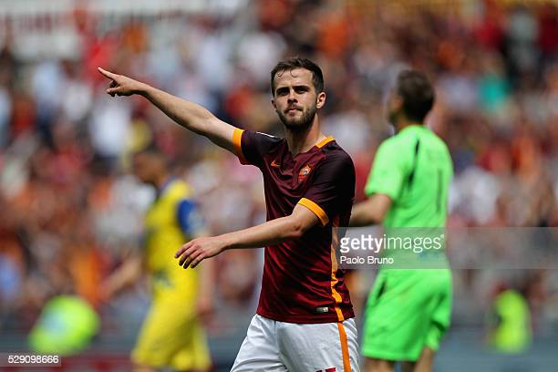 Miralem Pjanic of AS Roma celebrates after scoring the team's third goal during the Serie A match between AS Roma and AC Chievo Verona at Stadio...