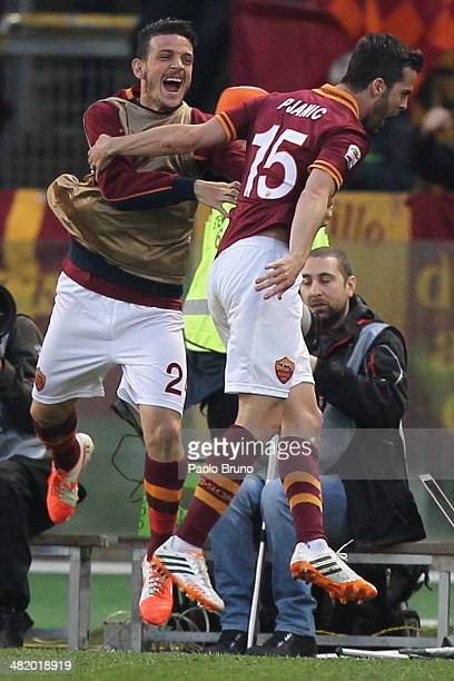 Miralem Pjanic of AS Roma celebrates with his teammate Alessandro Florenzi after scoring the third team's goal during the Serie A match between AS...