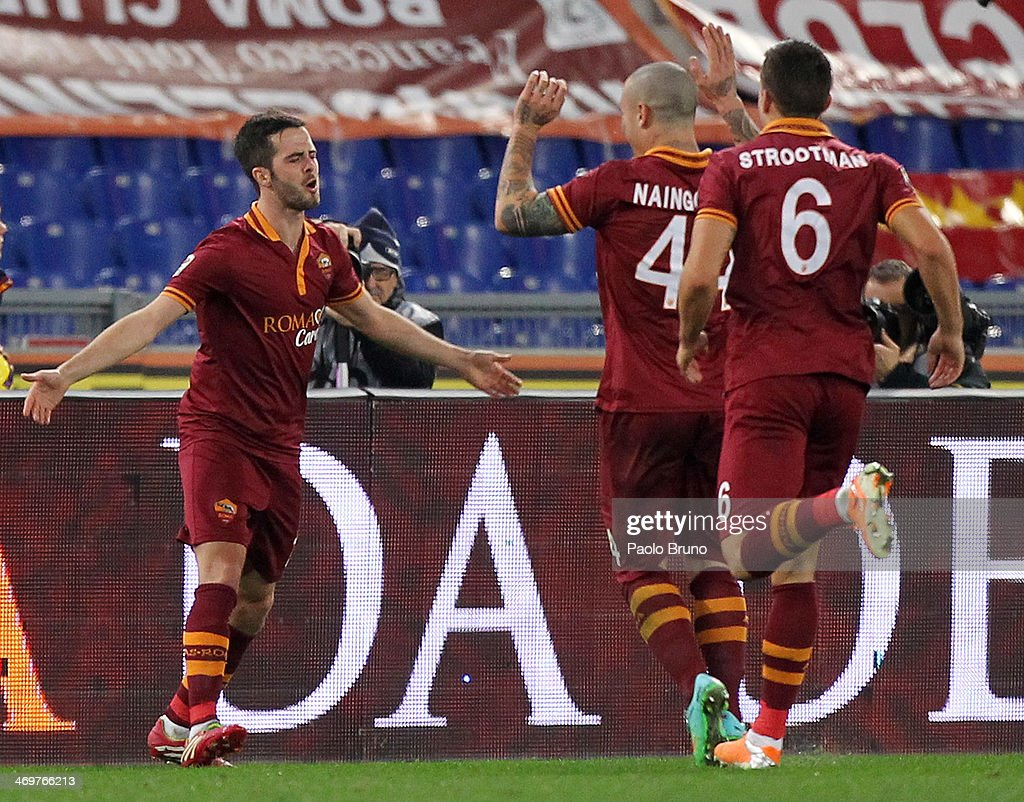 Miralem Pjanic of AS Roma celebrates with his teammates after scoring the second goal during the Serie A match between AS Roma and UC Sampdoria at Stadio Olimpico on February 16, 2014 in Rome, Italy.