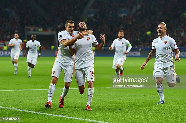 Miralem Pjanic of AS Roma celebrates with Lucas Digne and team mates as he scores their third goal during the UEFA Champions League Group E match...