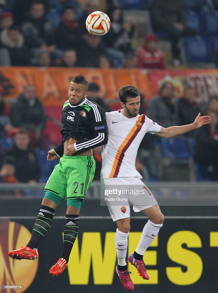 Miralem Pjanic (R) of AS Roma competes for the ball with Tonny Trindade de Vilhena of Feyenoord during the UEFA Europa League Round of 32 match between AS Roma and Feyenoord at Olimpico Stadium on February 19, 2015 in Rome, Italy.