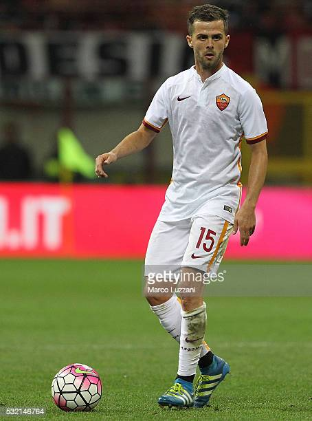 Miralem Pjanic of AS Roma in action during the Serie A match between AC Milan and AS Roma at Stadio Giuseppe Meazza on May 14 2016 in Milan Italy