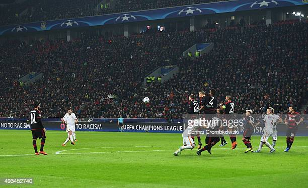 Miralem Pjanic of AS Roma scores their third goal from a free kick during the UEFA Champions League Group E match between Bayer 04 Leverkusen and AS...