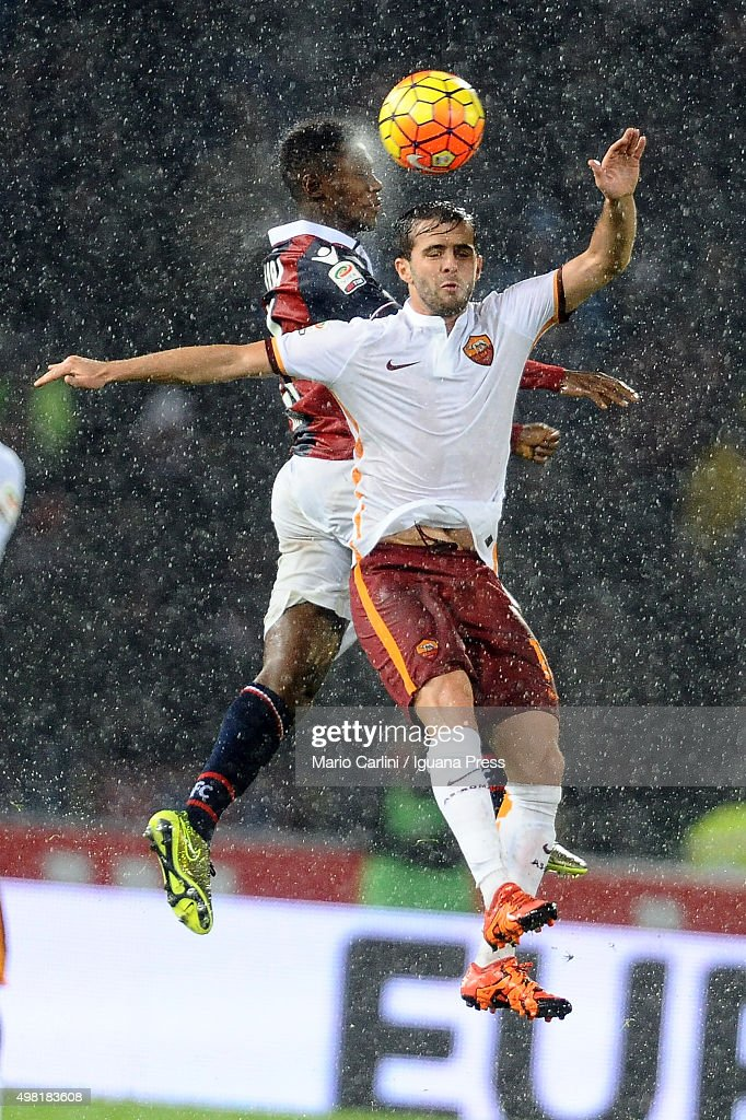 Miralem Pjanic # 15 of AS Roma ( R ) wins a header with Godfred Donsah # 30 of Bologna FC ( L ) during the Serie A match between Bologna FC and AS Roma at Stadio Renato Dall'Ara on November 21, 2015 in Bologna, Italy.