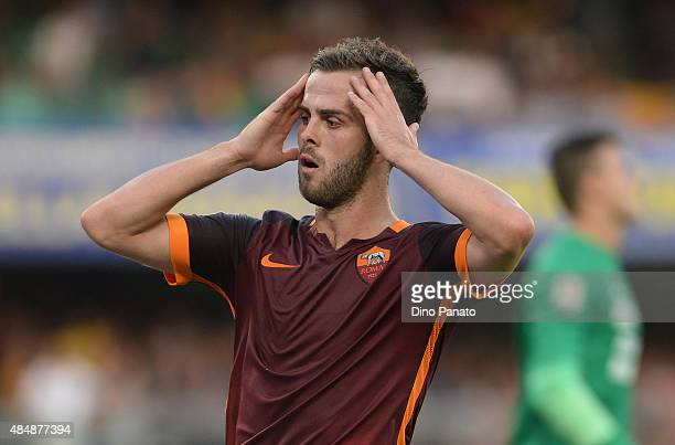 Miralem Pjanic of AS shows his dejection during the Serie A match between Hellas Verona FC and AS Roma at Stadio Marc'Antonio Bentegodi on August 22...