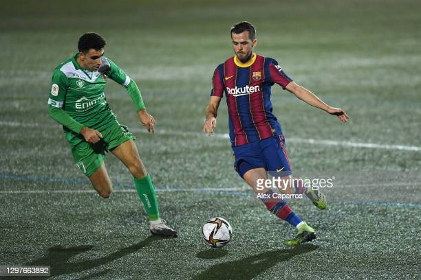 Miralem Pjanic of Barcelona is challenged by Javier Ontiveros Robles of Cornella during the Copa del Rey match between Cornella and FC Barcelona on...