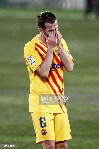 Miralem Pjanic of Barcelona reacts during the La Liga Santander match between SD Huesca and FC Barcelona at Estadio El Alcoraz on January 03, 2021 in...