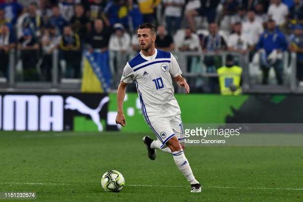Miralem Pjanic of Bosnia and Herzegovina in action during the 2020 UEFA European Championships group J qualifying match between Italy and Bosnia and...