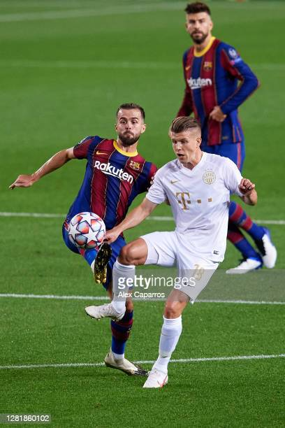 Miralem Pjanic of FC Barcelona battles for possession with David Siger of Ferencvaros Budapest during the UEFA Champions League Group G stage match...