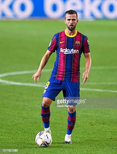 Miralem Pjanic of FC Barcelona runs with the ball during the La Liga Santander match between FC Barcelona and Villarreal CF at Camp Nou on September...