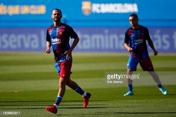 Miralem Pjanic of FC Barcelona warms up prior to a friendly match between FC Barcelona and Gimnastic de Tarragona at Johan Cruyff Stadium on July 21,...