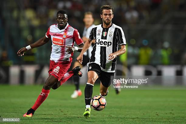 Miralem Pjanic of FC Juventus in action during the PreSeason Friendly match between FC Juventus and Espanyol at Alberto Braglia Stadium on August 13...