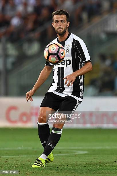 Miralem Pjanic of FC Juventus in action during the PreSeason Friendly match between FC Juventus and Espanyol at Alberto Braglia Stadium on August 13...