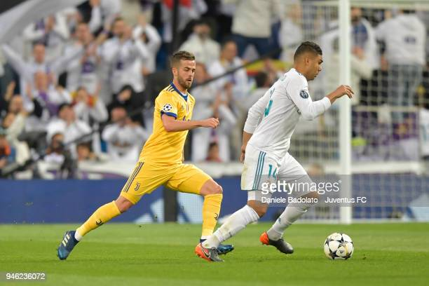 Miralem Pjanic of Juventus and Casemiro of Real Madrid in action during the Champions League match between Real Madrid and Juventus at Estadio...