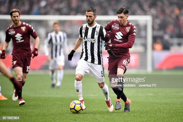 Miralem Pjanic of Juventus and Daniele Baselli of Torino during the serie A match between Torino FC and Juventus at Stadio Olimpico di Torino on...