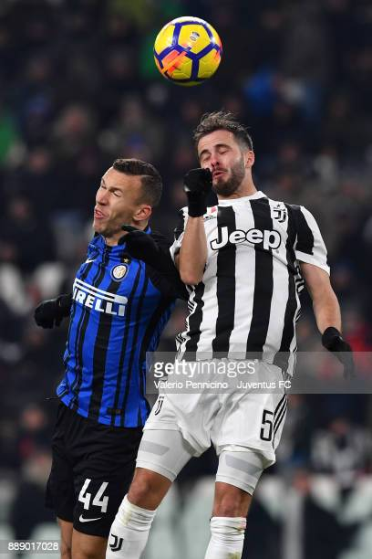 Miralem Pjanic of Juventus and Ivan Perisic of FC Internazionale head clashes during the Serie A match between Juventus and FC Internazionale on...