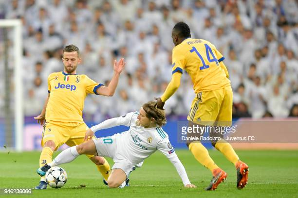 Miralem Pjanic of Juventus and Luka Modric of real Madrid in action during the Champions League match between Real Madrid and Juventus at Estadio...