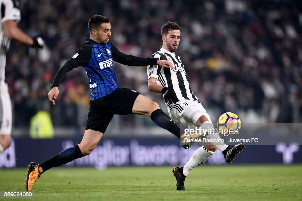 Miralem Pjanic of Juventus and Matias Vecino of FC Internazionale compete for the ball during the Serie A match between Juventus and FC...