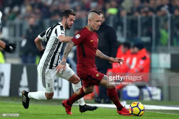 Miralem Pjanic of Juventus battles for the ball with Radja Nainggolan of AS Roma during the serie A match between Juventus and AS Roma at the...