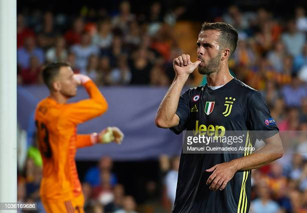 Miralem Pjanic of Juventus celebrates after scoring his sides first goal during the Group H match of the UEFA Champions League between Valencia and...