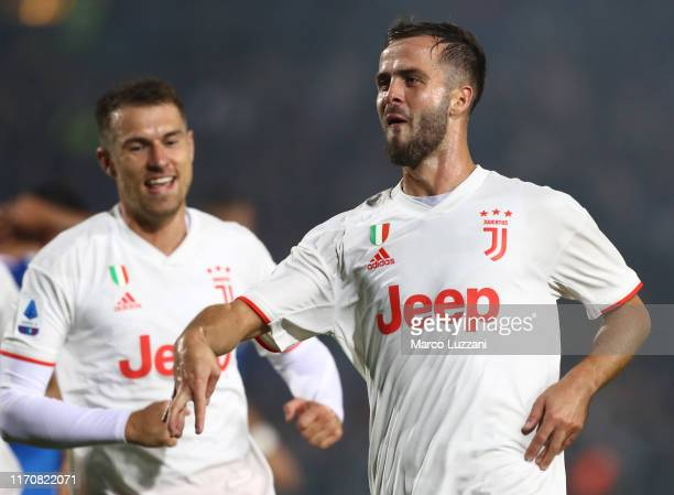 Miralem Pjanic of Juventus celebrates his goal during the Serie A match between Brescia Calcio and Juventus at Stadio Mario Rigamonti on September 24...